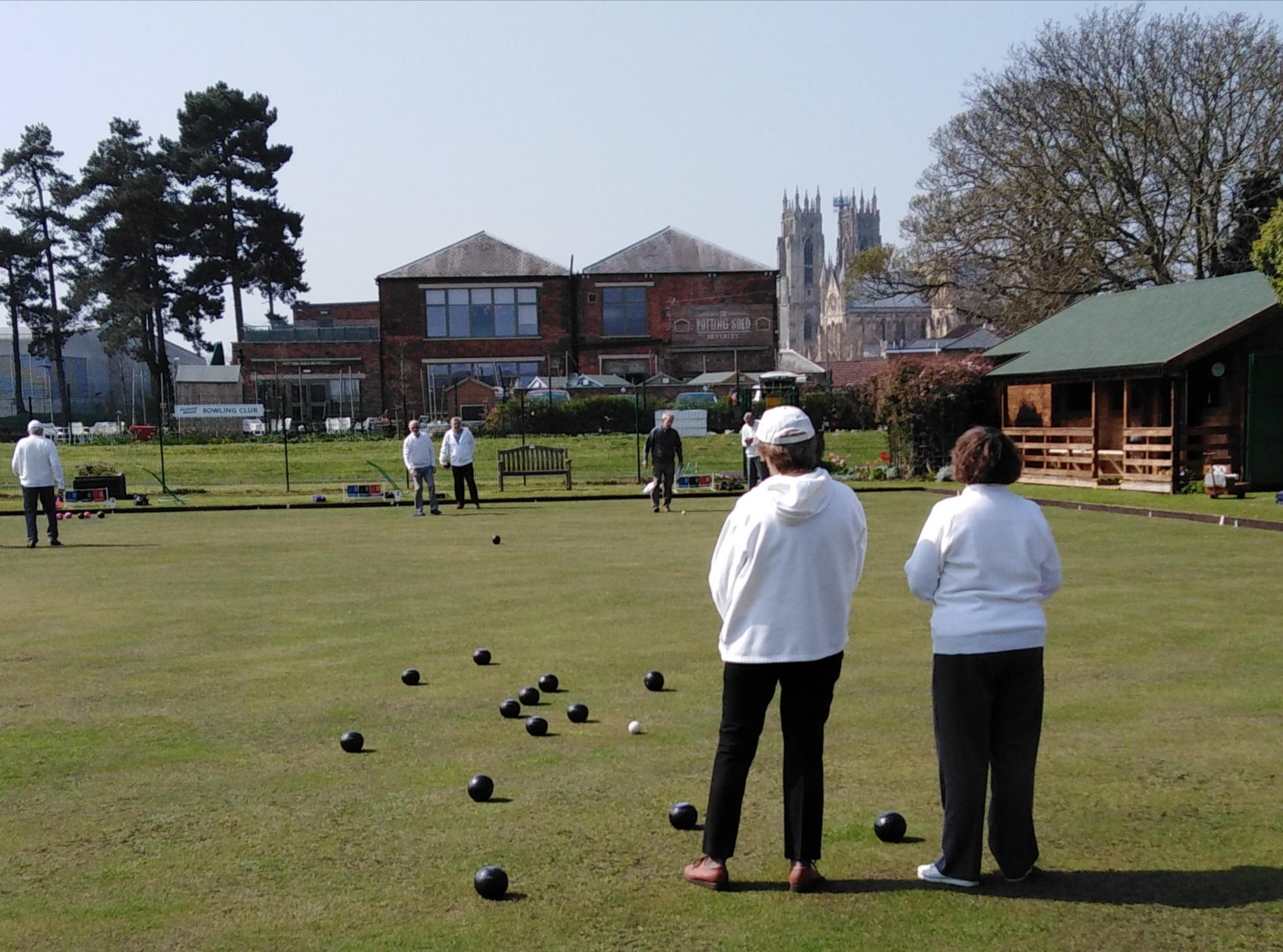 shows Beverley bowling club members enjoying a game of bowls in the spring sunshine.